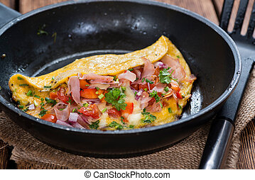 Homemade Ham and Cheese Omelette in a frypan