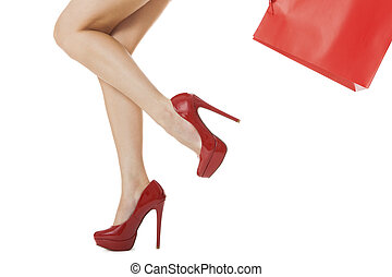 Woman Legs in Red High Heels Carrying Red Bag - Legs Shot -...