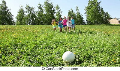 Group of girls run after the ball