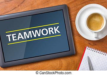 Tablet on a desk - Teamwork