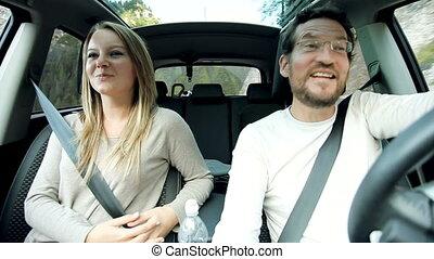 Couple in love in car talking