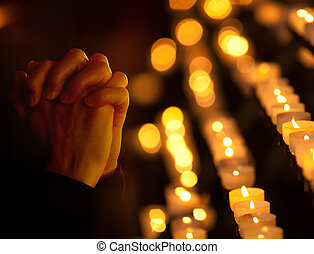 Praying in catholic church. Religion concept. - Praying in...