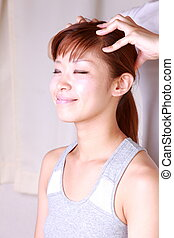 head massage%u3000 - young Japanese woman getting a head...