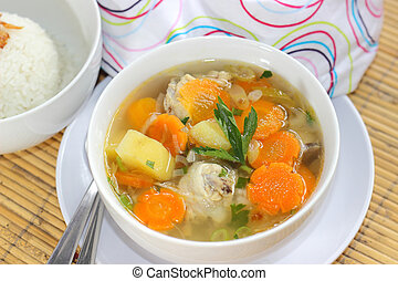Chicken Soup - A bowl of Chicken Soup served with slices of...