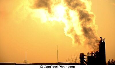 Emissions to the atmosphere industrial pipes View of the sun...