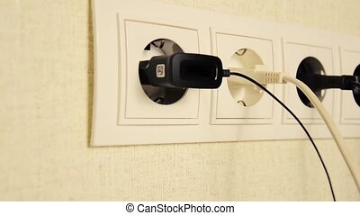 Electrical outlets with cables connekted. The movement of...