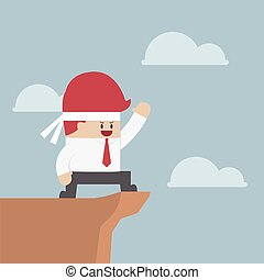 Motivated businessman on the cliff, Motivation concept,...