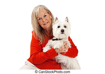Closeup of Mature Woman Holding Dog - A close-up photo of an...