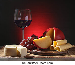 Refined still life of wine, cheese and grapes on wooden...
