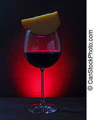 Glass of Red Wine with cheese on Lights Background - Close...