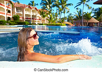 Woman in jacuzzi - Woman relaxing in jacuzzi. Vacation at...