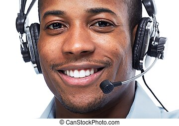 Man with headphones. Call center operator speaking with...