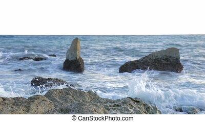 Water breaking in rocks - Water breaking into rocks of a...