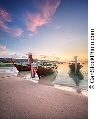sunset with colorful sky and boat on the beach - Beautiful...