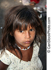Hopeful Poor Indian Girl - A portrait of a very poor Indian...