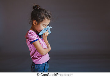 girl blowing his nose into a handkerchief - girl blowing his...