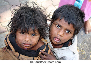 Poor Siblings - A portrait of a poor little girl from India...