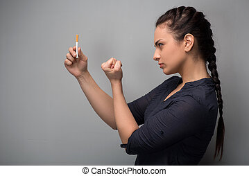 Addiction. Closeup of young woman determined girl holding...