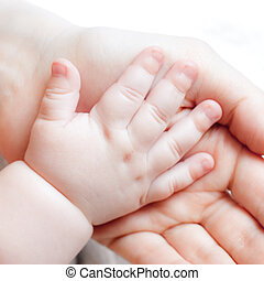 Tiny hand - Mother holding her child\'s hand