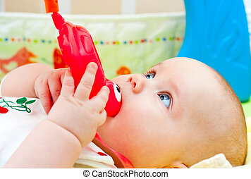 Infant with teething toy - Little baby girl playing with...