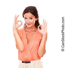 Charming young woman gesturing a great job while looking at...