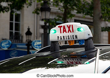 Paris Taxi - The Taxi sign on top of the roof of the cab in...