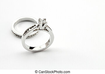 diamond solitaire ring and channel set on white background,...