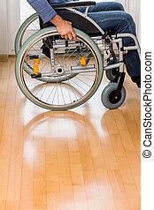 man in wheelchair - a man sitting in a wheelchair.