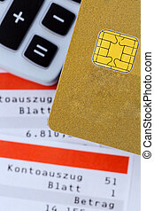 credit card, bank statement and calculator - a gold credit...