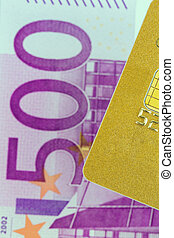 credit card and euro banknotes - a golden credit card and...