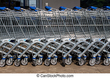 shopping cart outside a supermarket - in front of a...