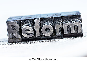 "written reform in lead letters - the word ""reform"" in lead..."