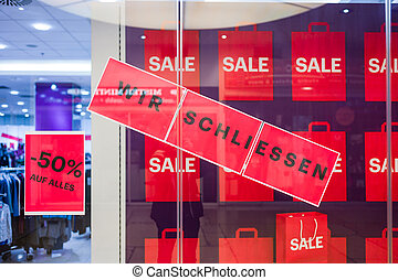 "sign: ""we conclude"" - a shop in a mall is closed for lack of..."