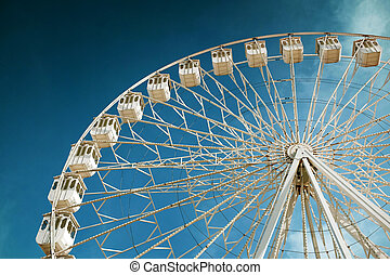 Giant Ferris Wheel - White ferris wheel in a fair and...