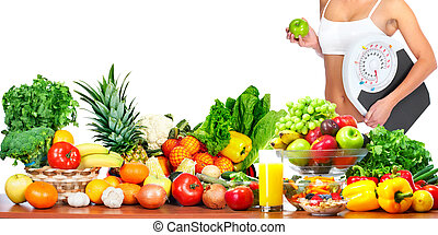 Woman with scales and apple fruits and vegetables background