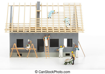Construction of cottages Workers at a construction site at...