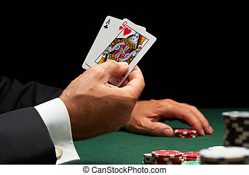 Blackjack hand of cards and casino chips - Blackjack player...