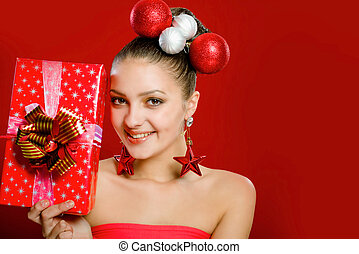 Beautiful girl with a gift box