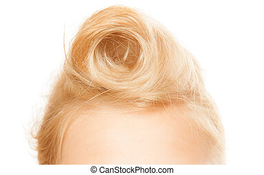 Pin-up hairstyle Closeup of female blond hair bun isolated...