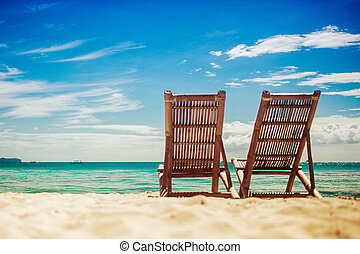 Two sitting place in the beach - Two sitting place in a...