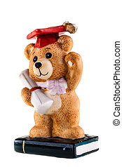 Phd teddy bear - a teddy bear figurine standing on a book...