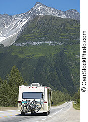 Canadian highway with motorhome and cars. British Columbia....