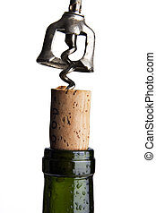 Uncork it - Close up of a corkscrew uncorking a bottle of...