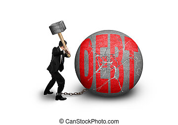 businessman holding hammer hitting cracked DEBT ball...