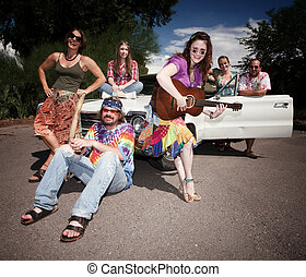 Groovy Group - Mixed group of happy modern adult hippies