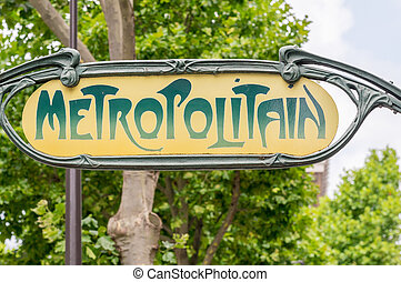 Metropolitain sign in Paris against trees.