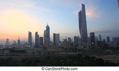 Skyline of Kuwait City at dusk Al Hamra Tower in the...