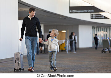 family at the airport - family of two at the airport with...