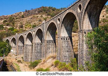 Old bridge in Sicily over the Alcantara river, Italy