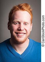 Redhead boy smiling looking at camera